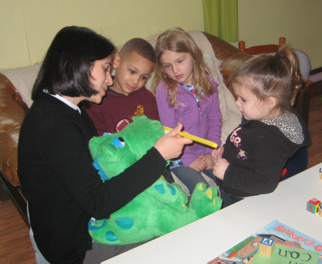 Dr. May reviewing toothbrushing with local preschoolers