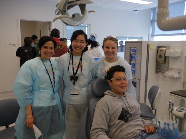 Dr. May with her students and young patients at the UOP School of Dentistry